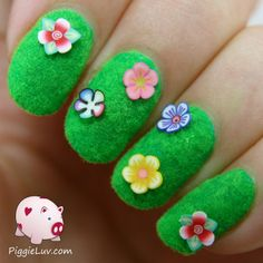 I have three different nail art designs on the blog, all of them using flocking powder! I tried to be creative and to think of new things, like a fuzzy bumble bee, a grassy mani with flowers, and some fuzzy shoes.