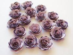 17 Lavender and Plum rolled paper flowers, wedding decoration,scrapbook decoration,table decoration, rosette,small flowers,embellishment by woolandmore on Etsy https://www.etsy.com/listing/200885006/17-lavender-and-plum-rolled-paper