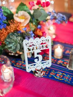 papel picado table numbers - photo by Rachel Solomon Photography http://ruffledblog.com/fiesta-inspired-arizona-wedding #MexicanWeddingIdeas