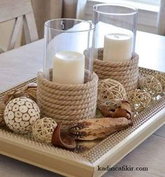 "See how I made my own sisal candle holders and used these from HomeGoods as my inspiration. Wrapping sisal around a glass candle holder is a great way to ""get the look"" on a budget. What a great coastal centerpiece! Diy Candle Holders, Diy Candles, Beeswax Candles, Decorating Candles, Diy Candle Stand, Nautical Candle Holders, Pillar Candles, Nautical Candles, Fireplace Candles"