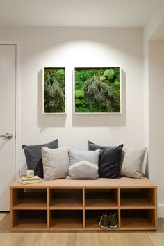 "Custom green artworks are actually living plants, made by <a href=""http://www.thesill.com/"" target=""_blank"">The Sill</a>."
