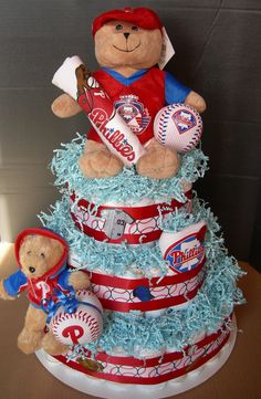 Made to order Custom Sports Team Diaper Cake by GKBabyGifts, $60.00.... I'm thinking one like this but  hawkeye of course
