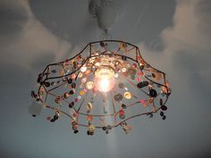 light fixture with vintage buttons ~~ Hammers and High Heels: Bachman's Spring Idea House: European Romance