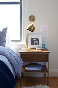 Alice Gao's Gramercy Apartment   A Cup of Jo   Issac sconce by Schoolhouse Electric