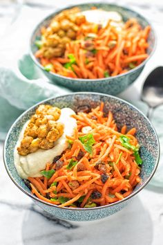 This vibrant Moroccan Carrot Salad is packed with fantastic flavors, entirely vegan and gluten free. With fresh, shredded carrots, spicy chickpeas, and creamy hummus this easy salad is seriously a must make for everyone.