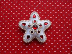 Create a Gorgeous Felt Christmas Ornament - DIY Home - Guidecentral. Guidecentral is a fun and visual way to discover DIY ideas, learn new skills, meet amazing people who share your passions and even upload your own DIY guides. Felt Christmas Decorations, Felt Christmas Ornaments, Beaded Ornaments, Christmas Toys, Cabin Christmas, Christmas Things, Christmas Star, Zipper Crafts, Felt Crafts Diy