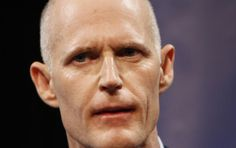 A federal judge on Saturday blocked Florida Governor Rick Scott's attempt to throw out tens of thousands of mail-in ballots, then publicly. reprimanded him. U.S. District Judge Mark Walker issued a blistering caution to the Scott's top election official on a lawsuit about vote-by-mail ballots.