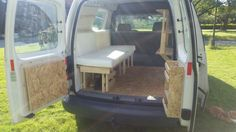 The mini camper now has some shelves and the beginnings of the foam bed.