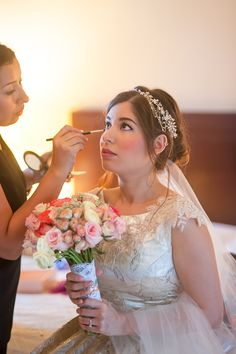 Cancun Wedding Photographer | Andrea just need a little touch up before she finally ready to walk the aisle for her beautiful Hacienda wedding | Getting dressed | Mexico luxury beach destination wedding photography