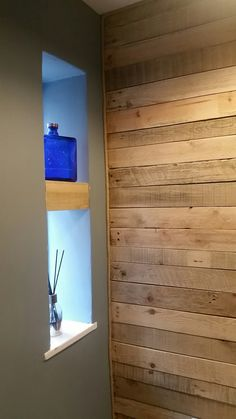 Pallet wood wall. With no nails shelf. Rope edging.