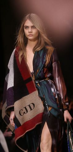 British model Cara Delevingne closing the Burberry A/W14 show in a personalised poncho