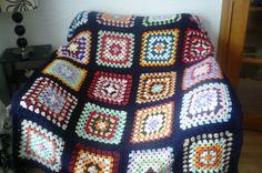 Granny Square Afghan edged in Navy by Aalexi on Etsy.
