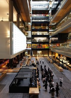 ANZ Centre by HASSELL. I love large open spaces like this that bring people together in one giant open structure while still keeping the spaces far enough apart to allow people to work or have some privacy. I also love the materials, textures, and colors used in this building. Lastly, I love the whole open layered layout of the building.