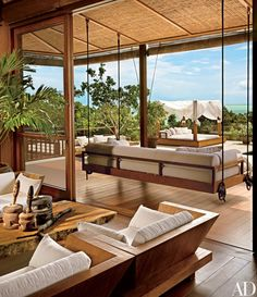 Donna Karan worked with interior designers Enrico Bonetti and Dominic Kozerski and architect Cheong Yew Kuan on her modern beach house in Turks and Caicos Indoor Outdoor Living, Outdoor Spaces, Outdoor Kitchens, Bali House, Terrace Design, Tropical Houses, Tropical House Design, Architectural Digest, Modern House Design