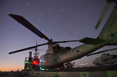 CORAL SEA (Aug 7, 2013) UH-1Y Hueys and AH-1W Super Cobras assigned to Marine Medium Tiltrotor Squadron (VMM) 265 (reinforced) sit on the flight deck of forward-deployed amphibious transport dock ship USS Denver (LPD 9) as she transits the Coral Sea. Denver is on patrol with the Bonhomme Richard Amphibious Ready Group and, with the embarked 31st MEU, is currently participating in certification exercise (CERTEX) in the U.S. 7th Fleet AOR. (U.S. Navy photo by Christopher Lindahl/Released)