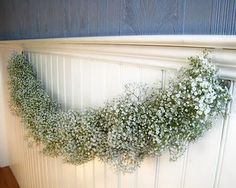 Love the idea of a soft garland of babies breath to frame the front door backdrop at the ceremony.