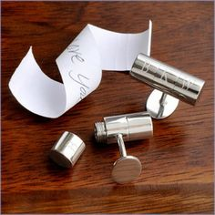 LEGIT secret agent cufflinks that can be personalized with initials. How cool would this be as a groom's gift with a little last minute secret love message inside. Aw.