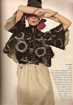 Tilly Tizzani in evening dress of parchment-colored silk overlaid with black lace embroidered with black flowers by Trigere, Vogue Feb. 1964