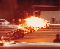 "Don ""The Snake Prudhomme's 'Hot Wheels"" Cuda blowing the engine in the lights at SIR."