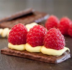 Try this recipe of the month from Jules Destrooper Belgian cookie company! Almond Thins enrobed with dark chocolate, topped with light ganache and Belgian raspberries. Only takes minutes to prepare for a wonderful presentation at your next event.