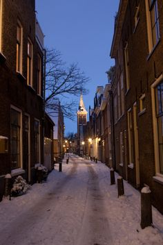 Gouda, The Netherlands.  Nothing better than snow covered streets at dusk