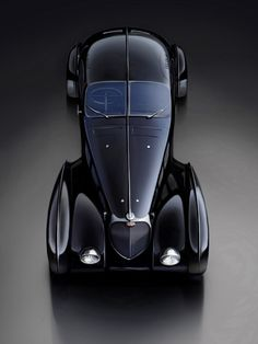 The Bugatti was unveiled in Paris in 1991 and went into production until Bugatti went out of business in 1995 (Bugatti has since been resurrected by Volkswagen). The car was available as a two-door sports car and only 31 cars were produced. Bugatti Veyron, Bugatti Cars, Bugatti Type 57, Vintage Cars, Antique Cars, Carros Audi, Automobile, Auto Retro, Sexy Cars