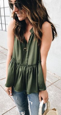 Green top styled with ripped denim