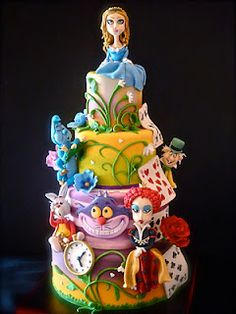 Cake in the shape of Alice in Wonderland characters.