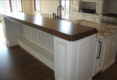 gourmet kitchen with wooden countertop with beveled edge Ivey Custom Homes, Knoxville TN