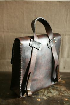 Leather bag for a man to carry what's important to him neatly and organized says a lot about him