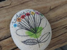 "Inspirational saying ""today is a gift"" hand written on authentic Lake Erie beach stone.  $14"