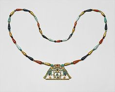 Pectoral and Necklace of Sithathoryunet with the Name of Senwosret II  Period: Middle Kingdom Dynasty: Dynasty 12 Reign: reign of Senwosret II Date: ca. 1887–1878 B.C. Geography: Egypt, Fayum Entrance Area, el-Lahun (Illahun, Kahun; Ptolemais Hormos), Tomb of Sithathoryunet (BSA Tomb 8), EES 1914