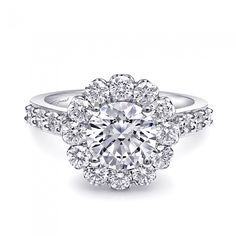A glamorous halo engagement ring featuring a mixture of bead and fishtail set diamonds. Shown with a 1.5CT center stone.