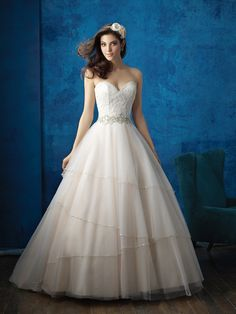 Sparkling asymmetry draws the eye to this strapless ballgown's full skirt // Allure Bridals 9351