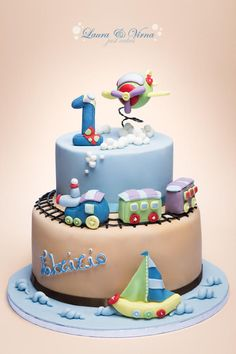 Beige & Baby Blue Airplane, Train and Sailboat Cake