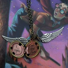 maybe buy a locket, paint it gold. then buy wing charms and add them on Harry Potter