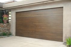 Custom wood garage door with horizontal slats. Want it? www.clopaydoor.com.