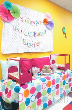A fun, colorful, and playful polka dot pajama birthday party, including tables dressed to look like beds, personalized pillowcase party favors, doll beds as cookie platters, and a polka dot cake! | www.allthingsgd.com #allthingsgd