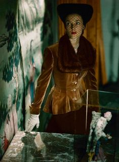 John Rawlings a. 1947 --- Model wearing pinch-waisted jacket, rippling longer in back, of blond French velveteen ribbed with mink, and chocolate wool skirt, surrounded by Asian art. Vintage Fashion Photography, Fashion Photography Inspiration, Photography Women, Classic Photography, Photography Portraits, Photography Ideas, Fashion Inspiration, 1940s Woman, Vintage Coat