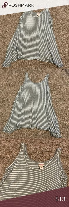 Grey and white Striped Ribbed Loose Tank Top Grey and white stripes. Great layering piece! A-line ribbed Tank Top. Worn once.     Feel free to make an offer using the offer button (please note: lowball offers will be declined), let's negotiate! 💞 NO OUTSIDE TRANSACTIONS OR TRADES ACCEPTED. Usually ships next business day. Please do not comment asking my lowest, those comments will be ignored. ALL OFFERS WILL BE FINAL SALE! Mossimo Supply Co. Tops Tank Tops