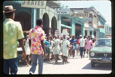 The Caribbean is a region that consists of the Caribbean Sea, its islands and the surrounding coasts. These amazing color photos from Rob Ketcherside that were taken by his grandfather, David Cook when he traveled to the Caribbean in 1975 and School Photography, Vintage Photography, Port Au Prince, Haitian Art, African Sculptures, West Indian, His Travel, Caribbean Sea, First Nations
