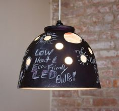 Chalkboard Lamp: Made from a used planter, its semi-random holes around the shade allows plenty of light onto the ceiling & walls.