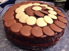 Vanilla Sponge Cake with butter-cream filling, warm chocolate frosting and chocolate buttons.
