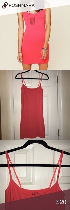 Free People Seamless Mini Slip Dress Free People Seamless Mini Slip • Intimately FP • Hot Poppy color (looks like a bright coral pinkish orange color) • size M/L ( still fits a size small due to stretchy form fitting material, but fits more loosely) • 92% nylon 8 % spandex • adjustable straps • very very gently used, no pilling Free People Dresses Mini