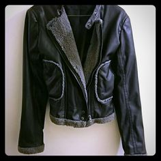 Sherpa lined faux leather motorcycle jacket Ultra rocker chick vibe with this fitted motorcycle jacket with sherpa lining and trim to keep you nice and warm. Jacket features snaps and zipper so you can adjust the fit. Worn once to a costume party; can't fit anymore. Jackets & Coats