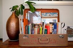 Vintage suitcase bookshelf from Apartment Therapy, artist Joan Hiller house tour. Vintage Suitcases, Vintage Luggage, Home And Deco, Bookshelves, Bookcase, Just In Case, Sweet Home, Diy Projects, Inspiration