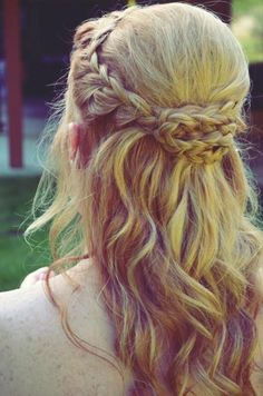 Half up half down crown braid with an interesting twist in the back.
