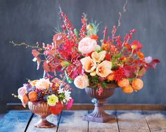 Late autumn centerpiece with garden rose, amaryllis, ilex, orchid, ranunculus, persimmon, fall foliage & explosion grass