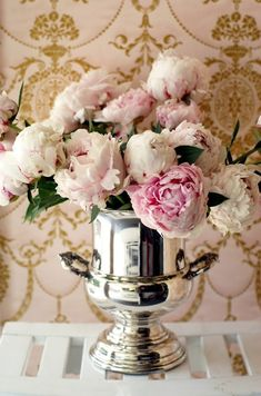 Peonies in a silver champagne bucket