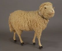 """antique lamb toy on wheels  Look, he's wearin' """"heelies""""!"""